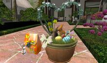 CJ Easter Planter with kissing Bunnys under Roseheart Bush