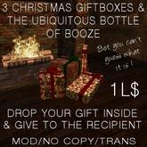 3 Christmas giftboxes & the ubiquitous bottle of booze!