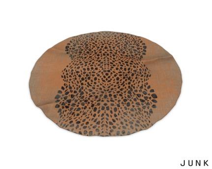 junk. round rug. orange print.