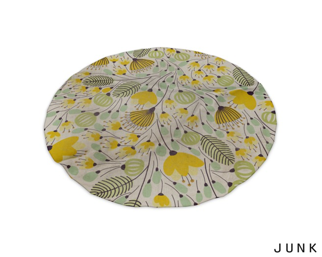 junk. round rug. yellow flower.