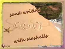 susu-*sand writing i love y with seashells*