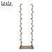 tarte. garden swing w foilage (light)