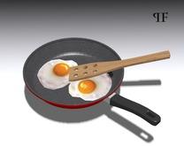 Fried eggs, pan, cooking spoon