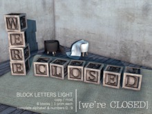 [we're CLOSED] block letters light