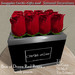 Box of dozen red roses   with poem