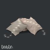 tarte. tossed pillows