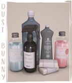 dust bunny . laundry room clutter . detergent bottles