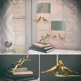 Calm. Wren Set - Gold Bird light Sconce & Paperweight with books