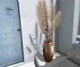 CJ Pampas Grass Sparsely Leafed Shrub in copper Vase