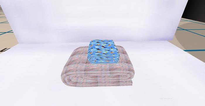 2 folded baby blankets