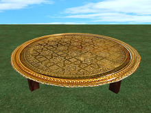 Table with brass tablet