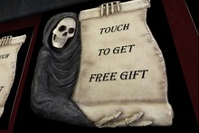 Grim Scroll Touch For Free Gift Sign