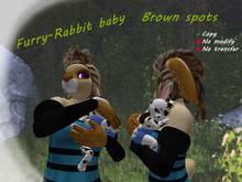 Furry-rabbit baby. Brown spots