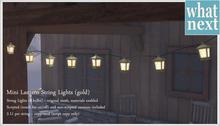 {what next} Mini Lantern String Lights - gold (mesh)