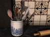Dutchie mesh white porcelain pot with delft blue decoration and kitchen utensils like a whisk, knife, spoon, spatula